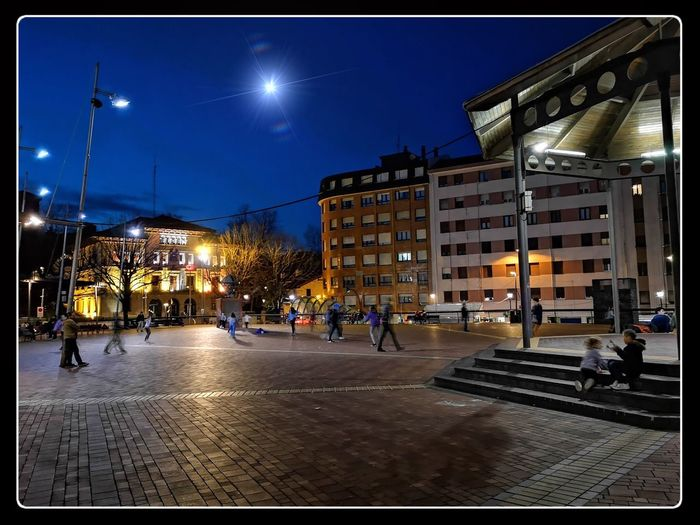 Building Exterior Architecture City Night Illuminated Built Structure Street Sky Street Light City Life Real People Outdoors Lighting Equipment City Street