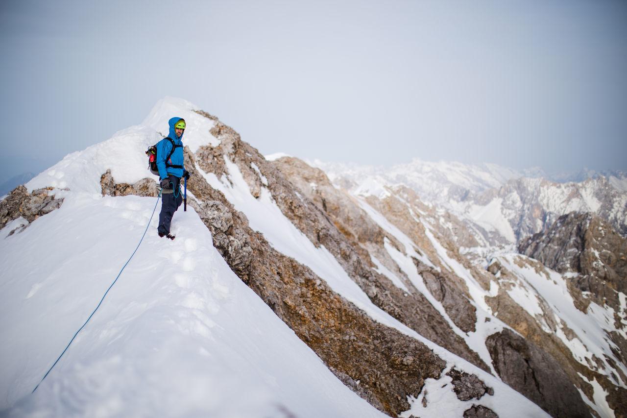 TOURISTS ON SNOWCAPPED MOUNTAIN
