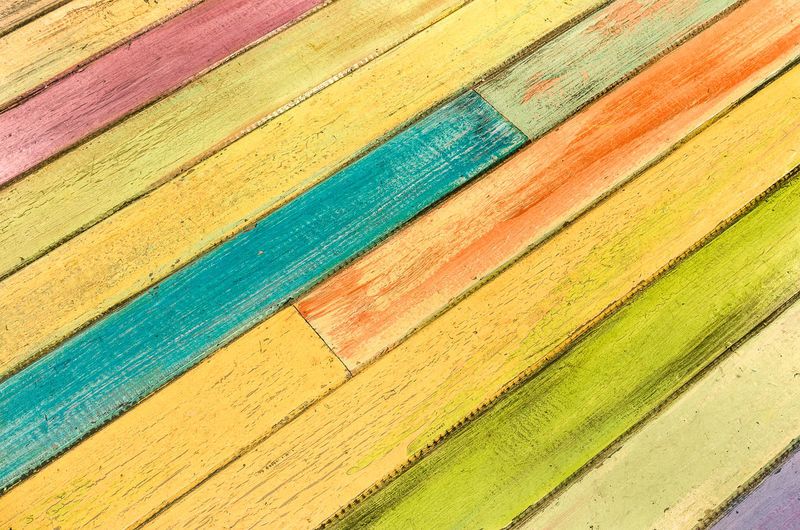 Multicolored wooden background as alternative construction material - Diagonal exture on wood floor at fashion restaurant - Retro seamless backdrop pattern - Vivid filter Wood Wood - Material Wooden Woodwork  Background Backdrop Pattern Textured  Texture Color Colour Vintage Pastel Multi Colored Multicolors  Carpentry Hipster Material Clipart Retro Style Fashion Cover Wallpaper Structure