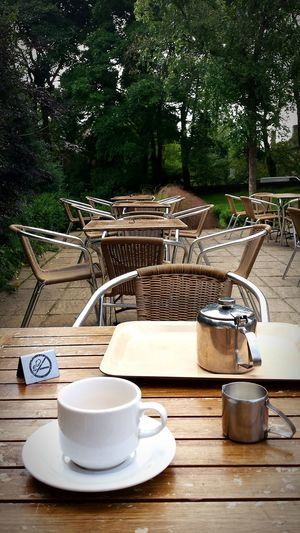 What I Value My first brew out and about since stopping smoking. Strange but nice. That little sign on the table would have prevented me from even taking the time out to have a cup of tea a month ago! Nosmoking Cafe Tea Earl Grey Tea Tables And Chairs POV Nature Time Out Relaxing