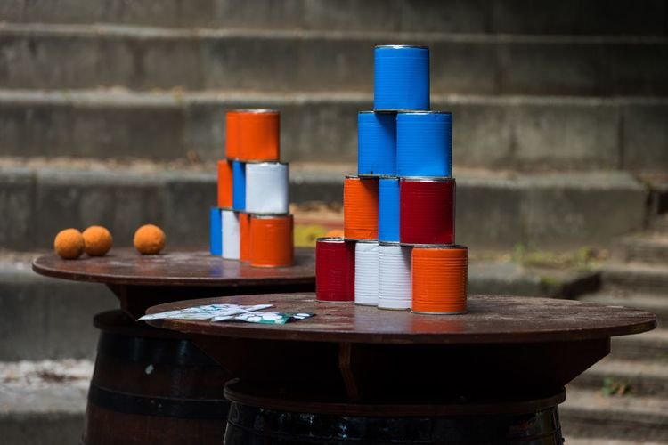 Blikgooien Blikgooien Dutch Game Typicaldutch Holland Colourful Red White Blue Orange Cans Balls Three Tower Gamesfromthepast Stairs Focus On Foreground Close-up Table Beertable Outdoors Nikond750 Building