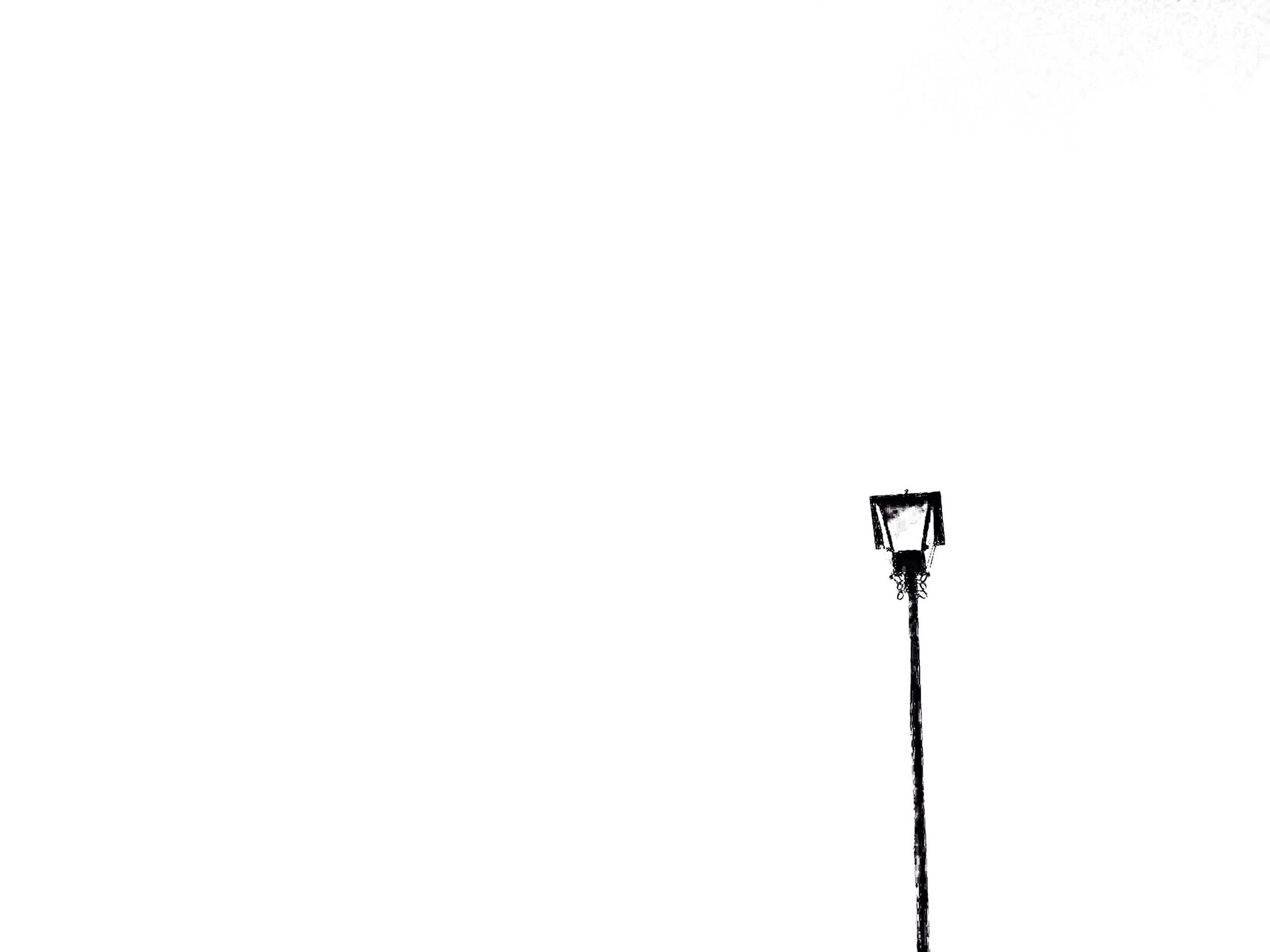 low angle view, copy space, clear sky, street light, electricity, lighting equipment, power line, cable, technology, connection, pole, high section, power supply, no people, outdoors, day, electricity pylon, fuel and power generation, nature, sky