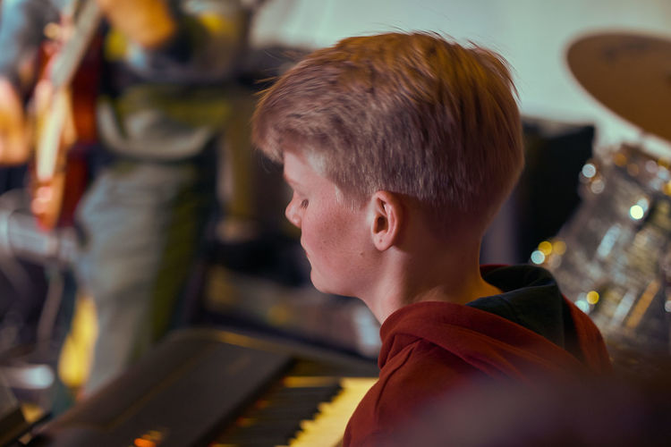 Close-up of teenage boy playing musical instrument