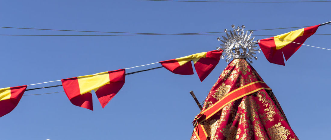 Romeria Zocueca Blue Bunting Celebration Clear Sky Day Flag Hanging Low Angle View Multi Colored No People Outdoors Patrimonio Etnológico Patriotism Red Religiosidad Popular Religiosidade Romería Virgen De Zocueca Sierra Morena Sky Wind ´bailén