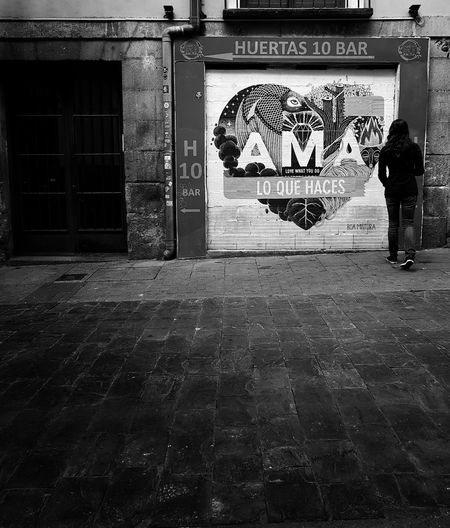 Man standing by wall in city