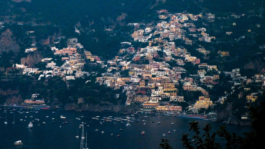 Early morning high angle view of city of positano coastline on amalfi coast by sea