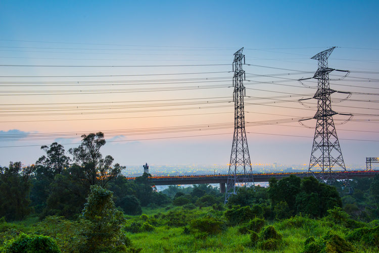 Beauty In Nature Cable Clear Sky Connection Day Electricity  Electricity Pylon Grass Landscape Nature No People Outdoors Sky Sunset Technology Tree