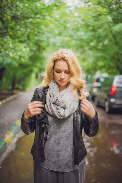 Beauty Blonde Hair Casual Clothing Day Focus On Foreground Footpath Front View Happiness Holding Long Hair Looking At Camera Looking Down Person Portrait Road Smiling Street Weekend Activities Young Adult Young Women