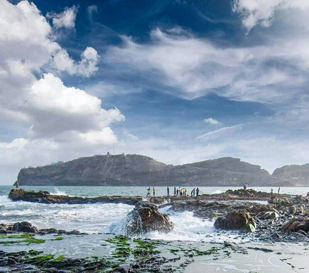 sea, cloud - sky, beach, water, nature, mountain, wave, outdoors, sky, scenics, no people, landscape, day, travel destinations, beauty in nature, motion, power in nature, blue, vacations, architecture