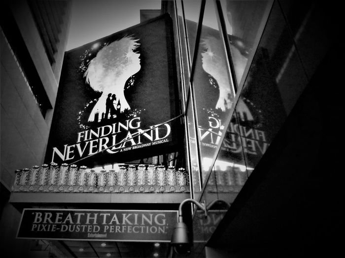 This is a Black and White shot of Finding Neverland Broadway Musical Logo. Big Shows Black And White Broadway Broadway Show Close-up Communication Glass Windows Logos Low Angle View Musical Theatre Musicals Musicals🎵 New York New York City New York City Life New York City Photos New York Trip New York ❤ New York, New York No People NYC Reflections Reflections In The Glass Windows Text Theatres