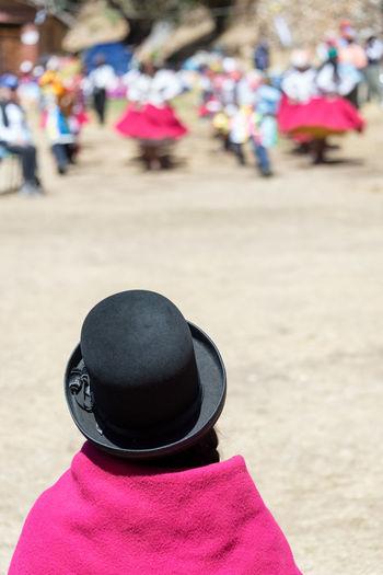 Rear view of woman wearing hat on street