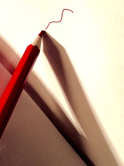 Red Pencil On Wall