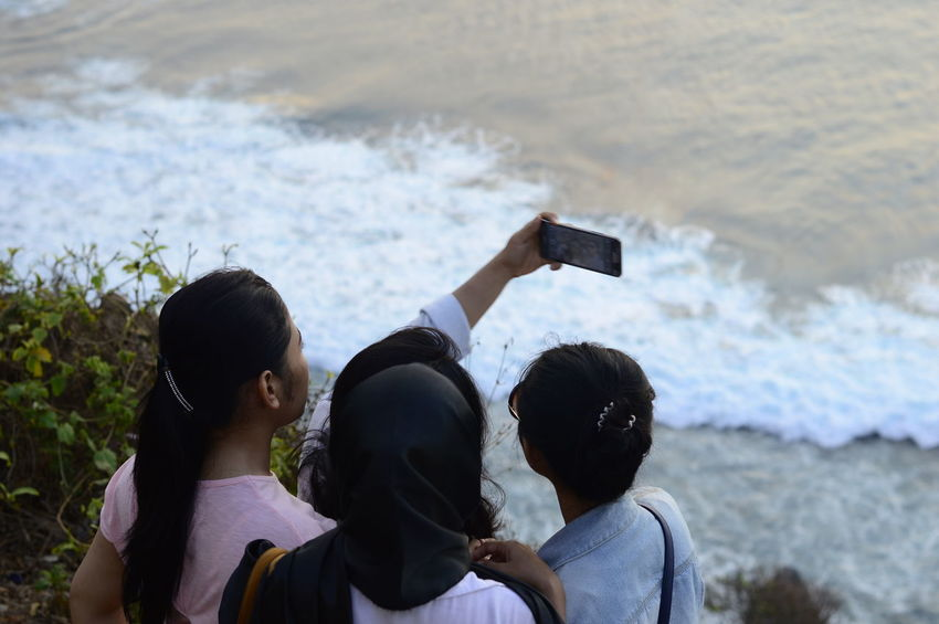 2/2 Uluwatu is a place on the south-western tip of the Bukit Peninsula of Bali, Indonesia. It was incredible hot climbing all steps but it's worth it! Casual Clothing EyeEm Nature Lover Fun Girls Group Group Photo Hijab Hijabstyle  Leisure Activity Lifestyles People People Watching Person Real People Sea Selfie The Tourist Togetherness Waves, Ocean, Nature INDONESIA