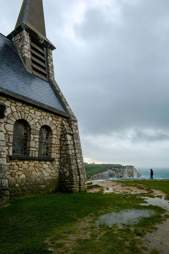 Architecture Built Structure Sky Building Exterior Building Cloud - Sky Grass History The Past Nature Place Of Worship Day Religion Belief Old Field Spirituality Outdoors étretat