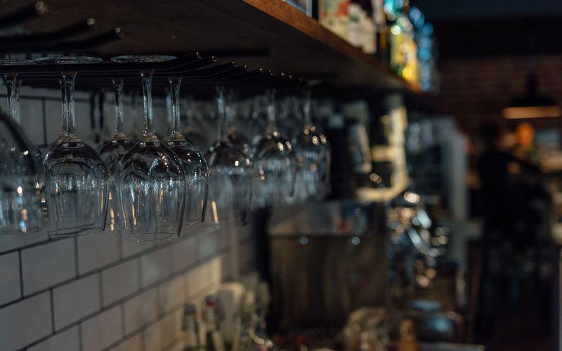 Upside down wineglasses hanging in bar