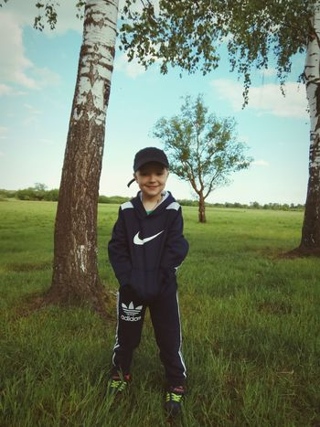 Child Tree Boys One Person One Boy Only People Standing Full Length Males  Day Rural Scene Grass Childhood Outdoors Children Only Sky Nature Adult