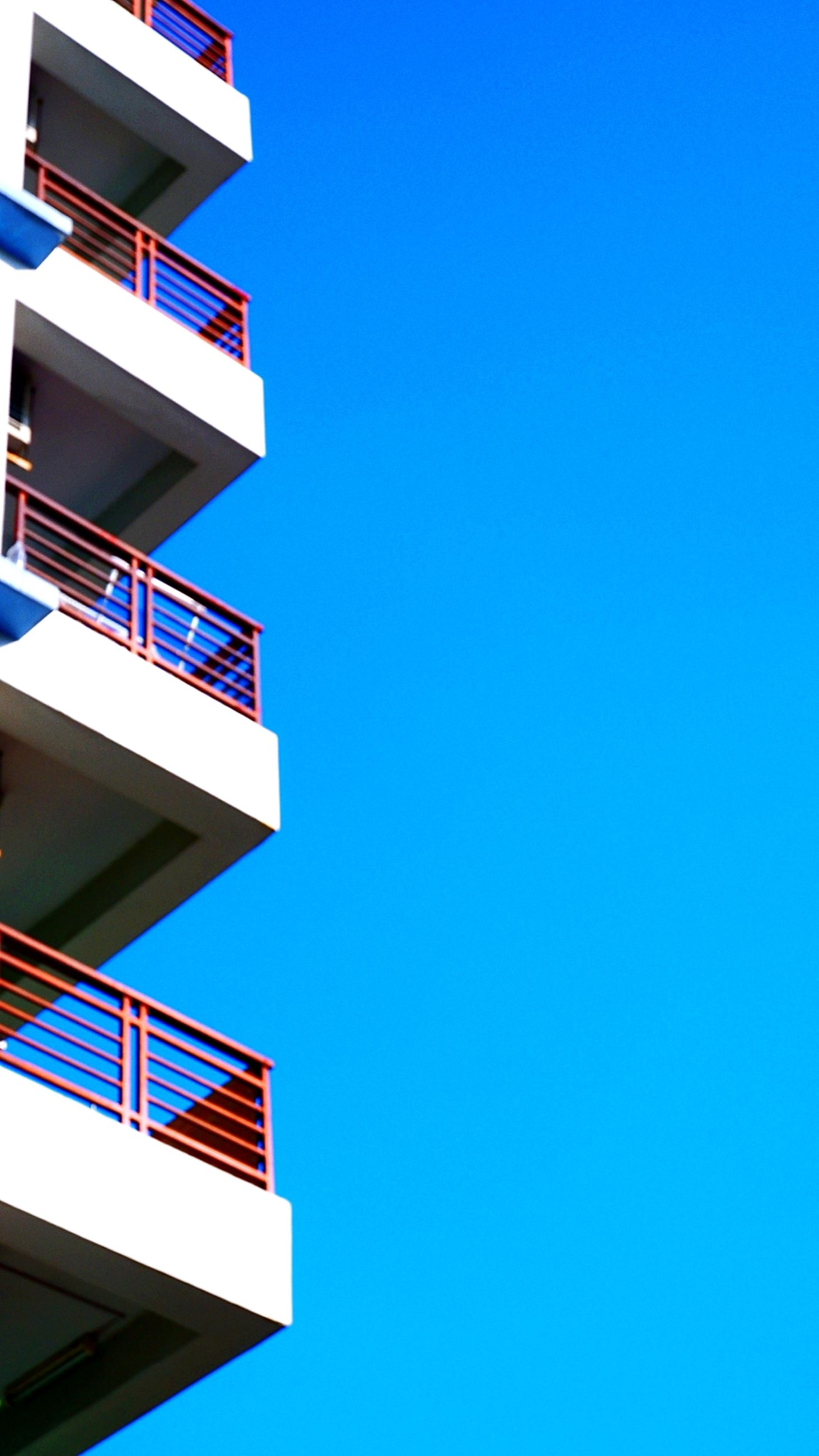 blue, architecture, built structure, clear sky, building exterior, sky, copy space, building, no people, tower, low angle view, nature, city, staircase, outdoors, day, sunny, line, residential district, facade