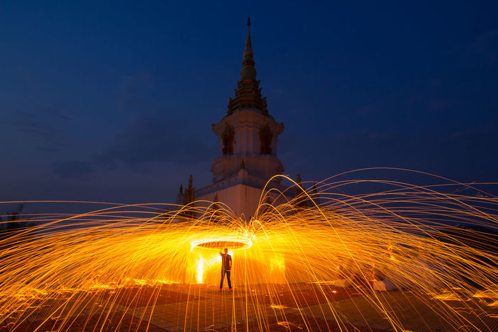Chiang Rai, Thailand Adult Firework Display Full Length Glowing Illuminated Lifestyles Long Exposure Men Motion Nature Night One Man Only One Person Orange Color Outdoors People Silhouette Sky Speed Standing Steelwool Steelwoolphotography Wire Wool Young Adult