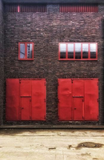 Garage Door Garage Brick Wall Bauhaus Firedepartment Architecture Built Structure Red Building Exterior No People Day Outdoors The Graphic City Colour Your Horizn