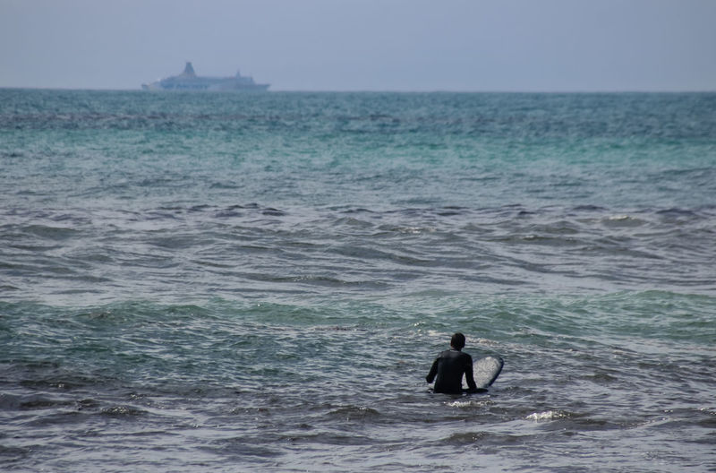 Alone Time Mediterranean Sea Surfer Waiting Aquatic Sport Beauty In Nature Boat Day Horizon Horizon Over Water Land Leisure Activity Lifestyles Men Motion Nature One Person Outdoors Real People Scenics - Nature Sea Sky Surfing Water Waterfront