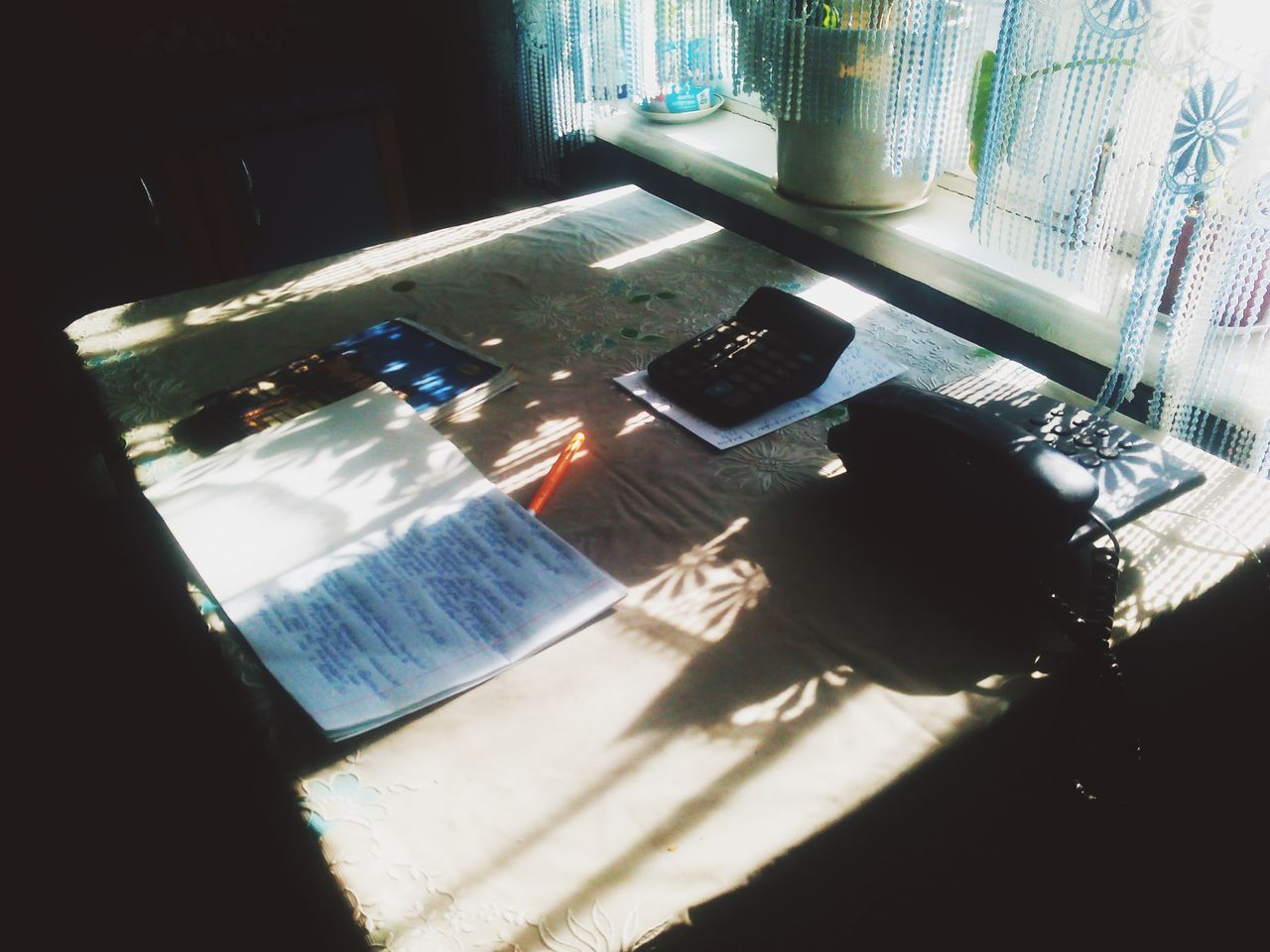 shadow, sunlight, indoors, high angle view, window, day, table, desk, home interior, no people, keyboard, close-up