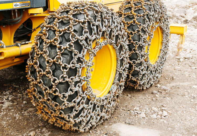 High angle view of chain on earthmover tire