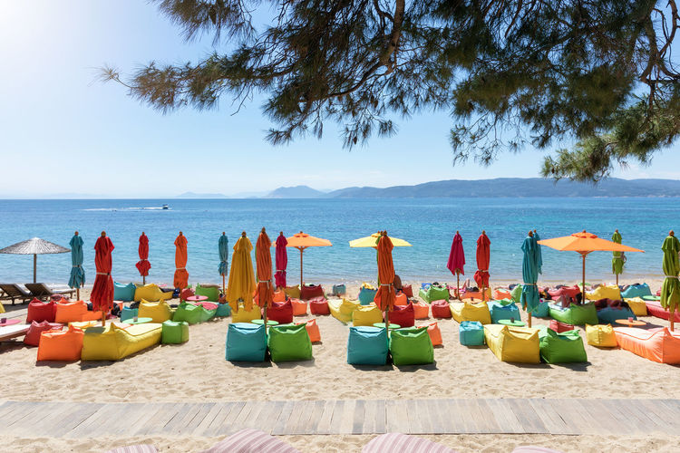 Popular Agia Eleni beach on Skiathos island, Sporades, Greece Aegean Sea Greek Mediterranean  Skiathos Vacations Agia Eleni Beach Color Day Greece Horizon Over Water Multi Colored No People Scenics - Nature Sea Seascape Sky Sporades Sports Summer Sun Tourism Travel Destinations Umbrella Water