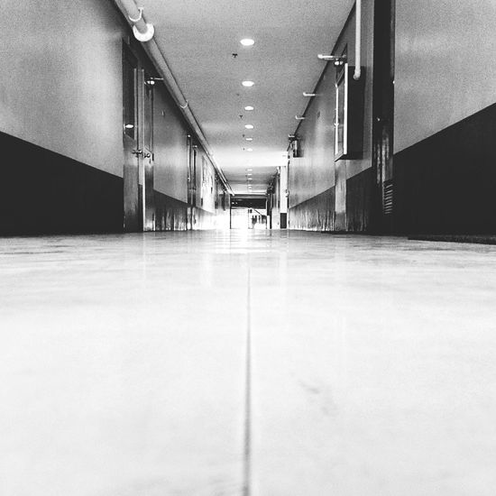 Hallway To Knowledge Empty No People Ceiling Light  The Way Forward Built Structure Blackandwhitephotography Architectural Feature Moments Of Life EyeEm Gallery School Days Morning Taking Photos AtPeace Relaxing Enjoying Life EyeEm Best Shots
