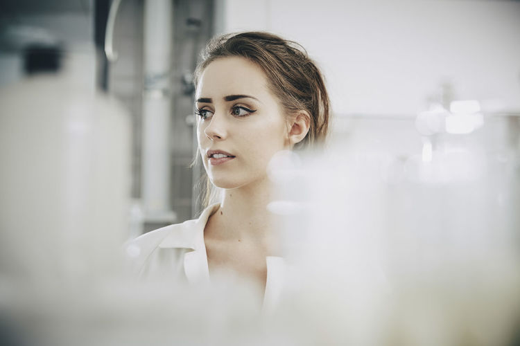 Portrait of young woman looking away