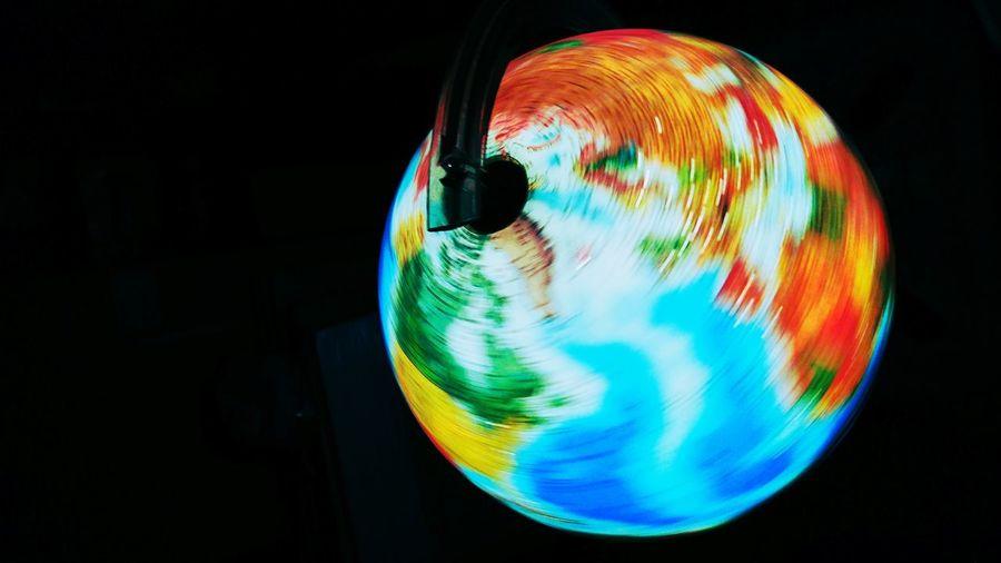 Close-up of illuminated globe against black background