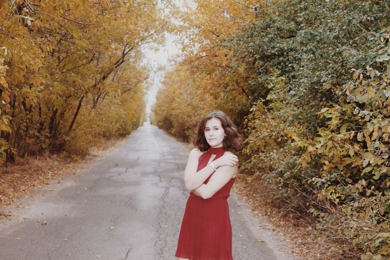 Autumn Looking At Camera Young Women One Person Young Adult Nature Red Portrait Beautiful Woman Only Women Outdoors Day Real People Leaf Adult One Young Woman Only People Beauty Tree Beauty In Nature