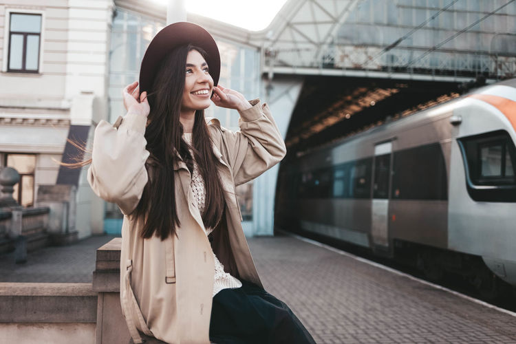 Woman standing at railroad station
