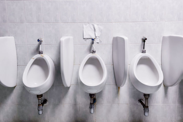 Row of people in bathroom