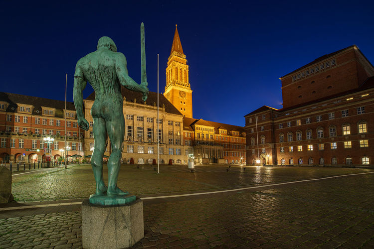 Statue of illuminated building against sky at night