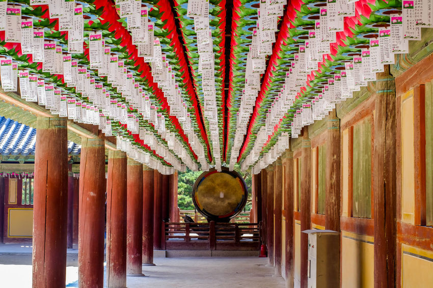 Hundred lanterns hanging at Bulguksa Temple Destination ASIA Ancient Geongju Korea Travel Architectural Column Architecture Budhist Bulguksa Ceiling Colorful Corridor Day Hanging Heritage In A Row Indoors  Multi Colored No People Temple Unesco