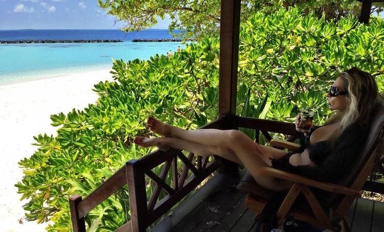Maldives Maldivesphotography Maldives Resorts Luxury Beachphotography Beachvilla Luxurylifestyle  Upscale Living Upscalelifestyle Relaxation Water Sitting Young Women Tree Person Resting Sea Lying Down Vacations Destination Travel Exotic Tropical Leisure Holiday