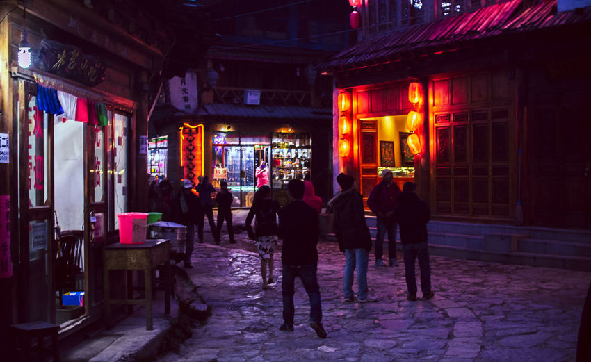Travel Destinations China Architecture Built Structure Building Exterior Night Illuminated Group Of People City Real People Street Building Men Women Lifestyles Leisure Activity Walking People Adult Incidental People Store Group