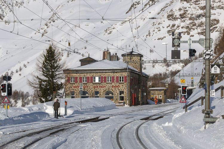 Bernina Express Station Alp Grüm Architecture Bernina Berninaexpress Building Building Exterior Built Structure City Cold Temperature Day Mode Of Transportation Nature Snow Snowing Train Train Station Transportation Tree White Color Winter