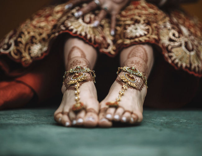 The feet of a bride are decorated with henna in Mehindi art for her wedding Indian Culture  IndianWedding Wedding Body Part Bride Celebration Close-up Fashion Human Foot Lifestyles Low Section Mandala Selective Focus Women