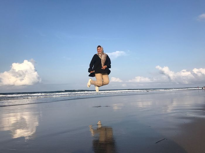 Jump EyeEm Selects Water Sky Sea One Person Beach Nature Full Length Leisure Activity Real People Reflection Outdoors Horizon Beauty In Nature Horizon Over Water Scenics - Nature Lifestyles Cloud - Sky Day Land