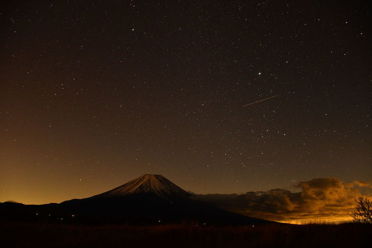 Scenic view of mountains against sky at night mt.fuji
