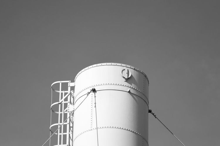 Low angle view of silo against clear sky