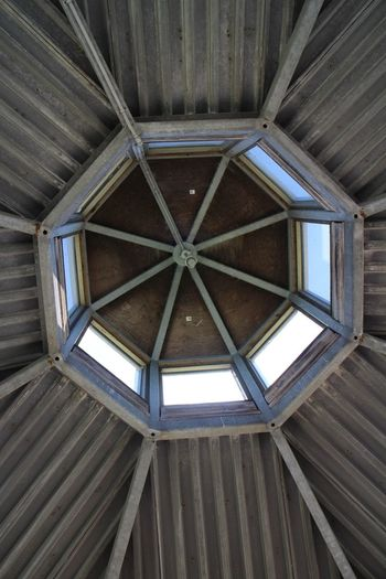 skylight • Octagon Shape Steel Structure  Ceiling Top Floor Look Out Tower Architecture Built Structure Ceiling Pattern Shape Indoors  No People Low Angle View Directly Below Geometric Shape Wood - Material Day Backgrounds Design Full Frame Building Skylight Roof The Architect - 2018 EyeEm Awards EyeEmNewHere