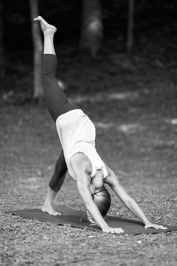 Young Woman Practicing Yoga At Park
