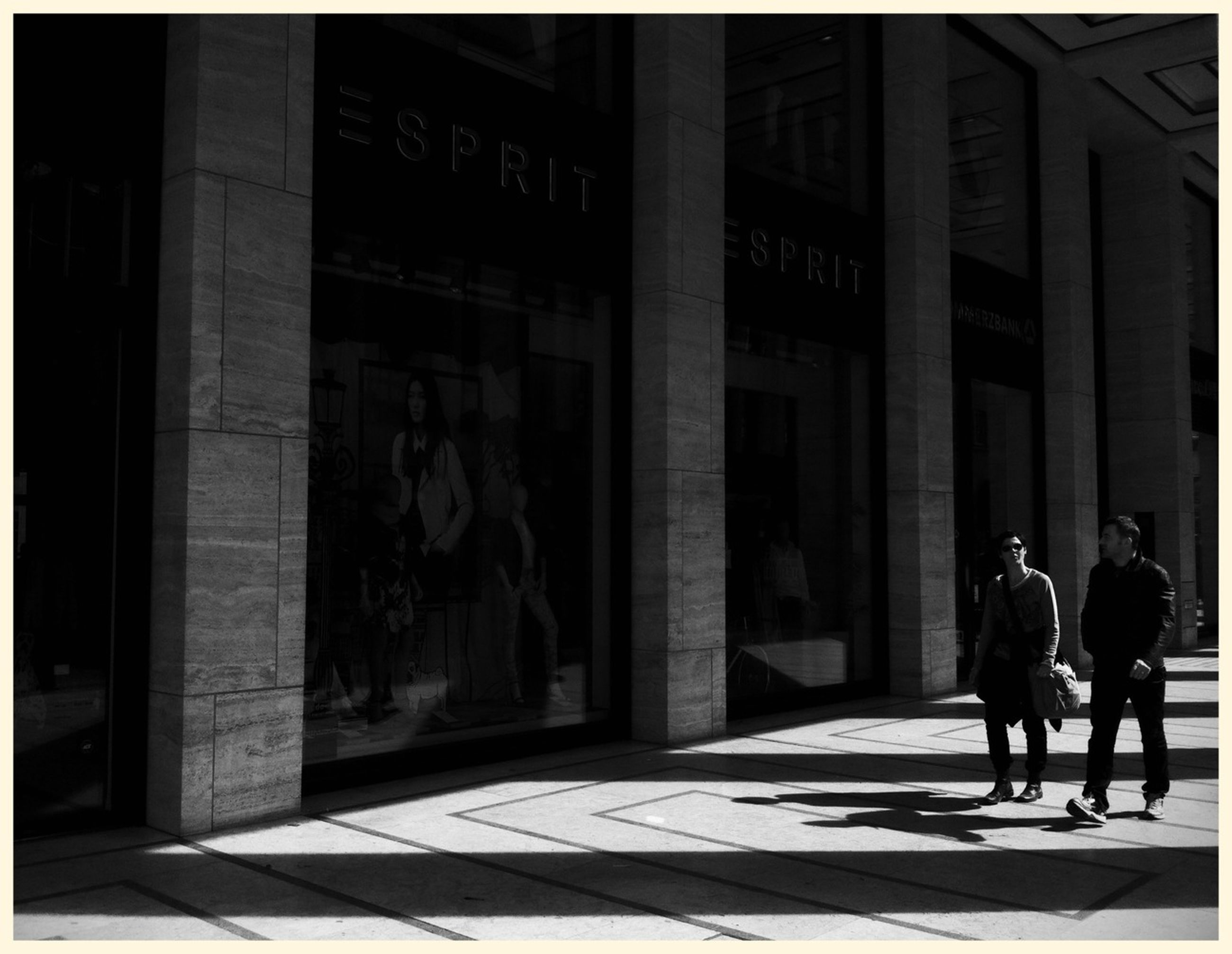 architecture, built structure, building exterior, city, walking, men, street, building, city life, sidewalk, full length, person, shadow, lifestyles, entrance, day, sunlight, outdoors