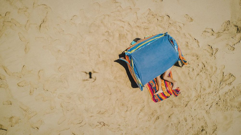 Someone is watching you Vol. 1 Sand Beach Summer High Angle View No People Vacations Nature Outdoors Outdoor Photography The Great Outdoors - 2017 EyeEm Awards The Portraitist - 2017 EyeEm Awards Drone  Dronephotography Aerial View Vertical Shot Self Portrait Legs Life Is A Beach Drone Selfie Live For The Story Sunbathing BYOPaper!