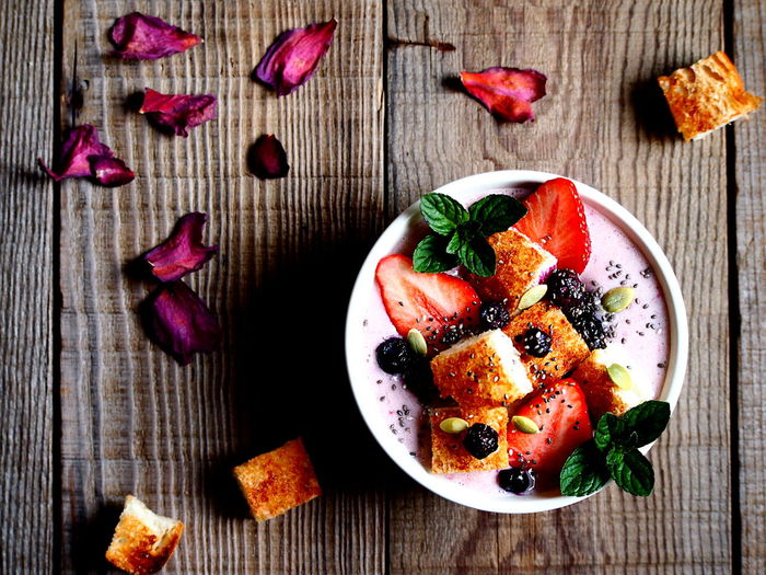 Strawberry Smoothie Bowl with Cinnamon Toast Breakfast Close-up Focus On Foreground Food Food And Drink Food Art Food Photography Food Styling Freshness Fruit Healthy Eating High Angle View My Point Of View Pink Color Sweet Food Table Temptation Wood - Material Art Is Everywhere Visual Feast Food Stories