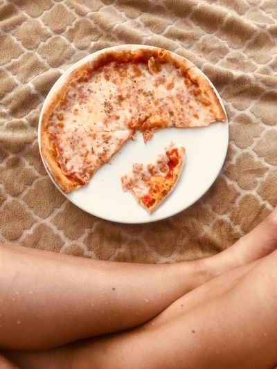 Pizza Pizza Food And Drink Food Human Body Part Indoors  Freshness Body Part High Angle View Healthy Eating Human Leg Plate Adult Relaxation Lifestyles Wellbeing Sand One Person Human Limb Refreshment Still Life Drink