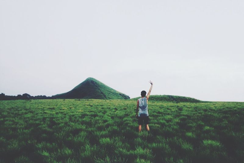 Green Color Nature Clear Sky Grass Leisure Activity Lifestyles Landscape Real People One Person Field Full Length Young Adult Standing Rear View Tranquil Scene Beauty In Nature Tranquility Outdoors Day Scenics