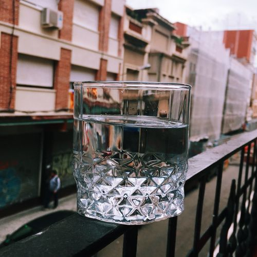 Glass of water on the railing of a balcony City Balcony Railing Water Glass Of Water Thirsty  Thirst Outdoors Glass Glass - Material Drink Drinking Glass Food And Drink Refreshment Close-up No People Transparent